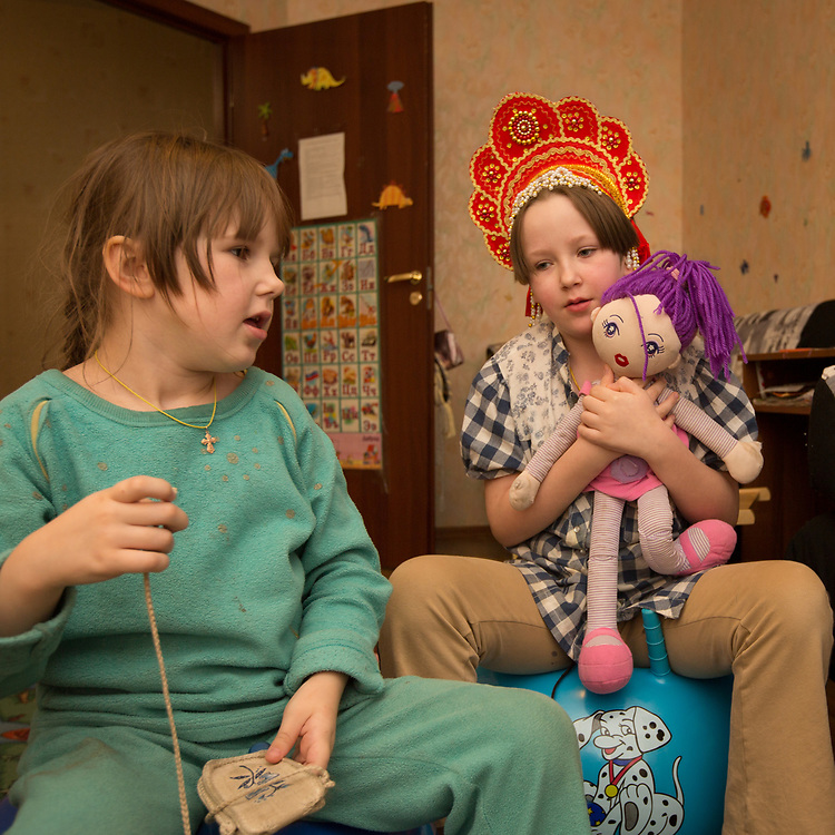 """CAPTION: Sofia and Izabella are both autistic. Their mother Natalya, whose husband has left her and had his parental rights revoked, occasionally receives help from a carer named Tatiana through Partnership For Every Child (P4EC)'s Short Break Service. She says, """"without the Short Break Service, I would manage but it would be difficult. I would have to take my daughters everywhere"""". LOCATION: St Petersburg, Russia. INDIVIDUAL(S) PHOTOGRAPHED: Sofia Shanina (left) and Izabella Shanina (right)."""