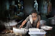 A man making paneer in the backstreets of a Jaipur bazaar, Jaipur, India