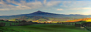 The Mount Amiata, visible from everywhere in Val d'Orcia, is a quescient volcano, the highest and largest of Italy. Taken at sunrise from the small hamlet known as La Foce, not far from Montepulciano in Tuscany, Italy