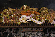 Meat grilling at a birthday party at a house in the 12 de Octubre barrio in Caracas, Venezuela.