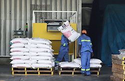 August 10, 2017 - Dar Es Salaam, Dar es Salaam, Tanzania - Workers sort bags of fertilizer at the Yara Tanzania fertilizer terminal. It is the country's largest private sector fertilizer manufacturer. (Credit Image: © Ric Francis via ZUMA Wire)