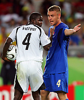 Hanover 12/6/2006 World Cup 2006<br /> <br /> Italia Ghana 2-0<br /> <br /> Photo Andrea Staccioli Graffitipress<br /> <br /> DAniele De Rossi Italy discute con Samuel Kuffour Ghana