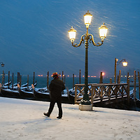 VENICE, ITALY - DECEMBER 17:  Gondolier walks in the snow in San Marco on December 17, 2010 in Venice, Italy. Snow has fallen across much of Europe today and is expected to continue over the weekend, causing traffic chaos and disrupting Christmas deliveries.