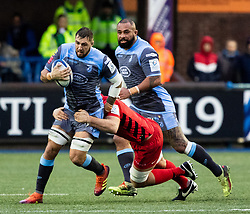 Josh Turnbull of Cardiff Blues under pressure from George Kruis of Saracens<br /> <br /> Photographer Simon King/Replay Images<br /> <br /> European Rugby Champions Cup Round 4 - Cardiff Blues v Saracens - Saturday 15th December 2018 - Cardiff Arms Park - Cardiff<br /> <br /> World Copyright © Replay Images . All rights reserved. info@replayimages.co.uk - http://replayimages.co.uk