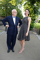MANOLO BLAHNIK and CHRISTINA BLAHNIK at the Fashion Rules Exhibition Opening at Kensington Palace, London W8 on 4th July 2013.