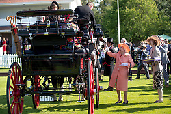 Queen Elizabeth II presents trophies to the winners of the Out-Sourcing Royal Windsor Cup final at the Guards Polo Club, Windsor Great Park, Egham, Surrey.