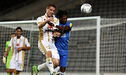 Isaac Buckley-Ricketts of Peterborough United in action with Mitch Hancox of Milton Keynes Dons - Mandatory by-line: Joe Dent/JMP - 04/09/2018 - FOOTBALL - Stadium MK - Milton Keynes, England - Milton Keynes Dons v Peterborough United - Checkatrade Trophy