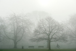 © Licensed to London News Pictures. 01/04/2014. Hammersmith, UK. A person cycles across the park.  A foggy morning in Ravenscourt Park in Hammersmith West London today April 1st 2014. Photo credit : Stephen Simpson/LNP