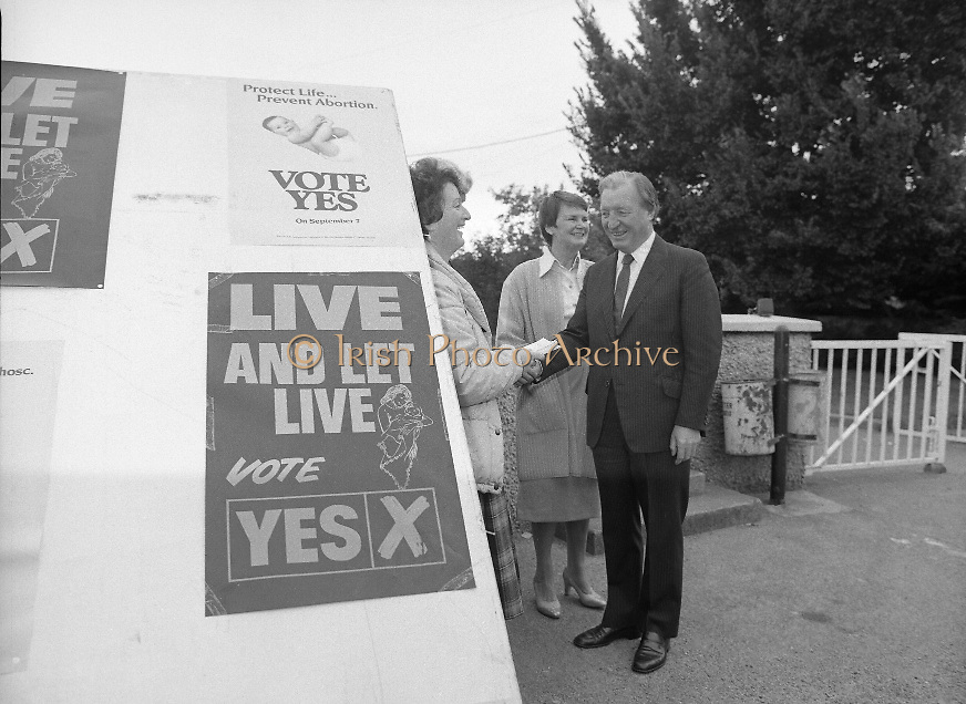 """Charles Haughey Votes in Referendum..1983.07.09.1983.09.07.1983.7th September 1983..Photograph of Mr and Mrs Haughey meeting with """"Yes"""" (pro amendment).Campaigner Ms Mary Jones...The referendum was a constitutional amendment with regard to the life of the unborn...  It was a divisive campaign with much debate, charge and countercharge by both sides of the argument..Those in the Yes campaign won the day with a vote of 841,233 to a no vote of 416,136."""
