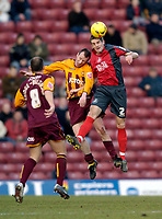 Photo: Jed Wee.<br />Bradford City v Swansea City. Coca Cola League 1. 14/01/2006.<br />Swansea's Sam Ricketts (R) jumps highest to win the ball.