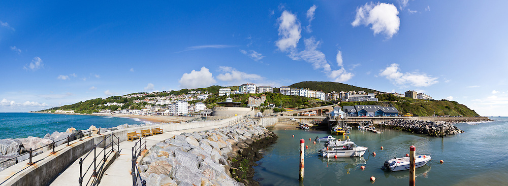 A panoramic view of Ventnor looking back towards the town from the new harbour wall. <br /> <br /> Created from four frames shot with the Sigma 10-20mm at f4.0 1/1000<br /> <br /> Part of the Ocean Seen - Oceanic Photography Exhibition.<br /> <br /> Sponsored by Wightlink - Dimbola Museum & Galleries, Freshwater Bay, Isle of Wight - 29th June to 2nd September 2012.<br /> <br /> A collaborative summer show, bringing together three great oceanic photographers to celebrate the way we interact with our great British coastline.