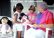 Active Aging Senior Citizens, Retired, Activities, Caucasian and Asian American children and Grandparent, Playing Dolls