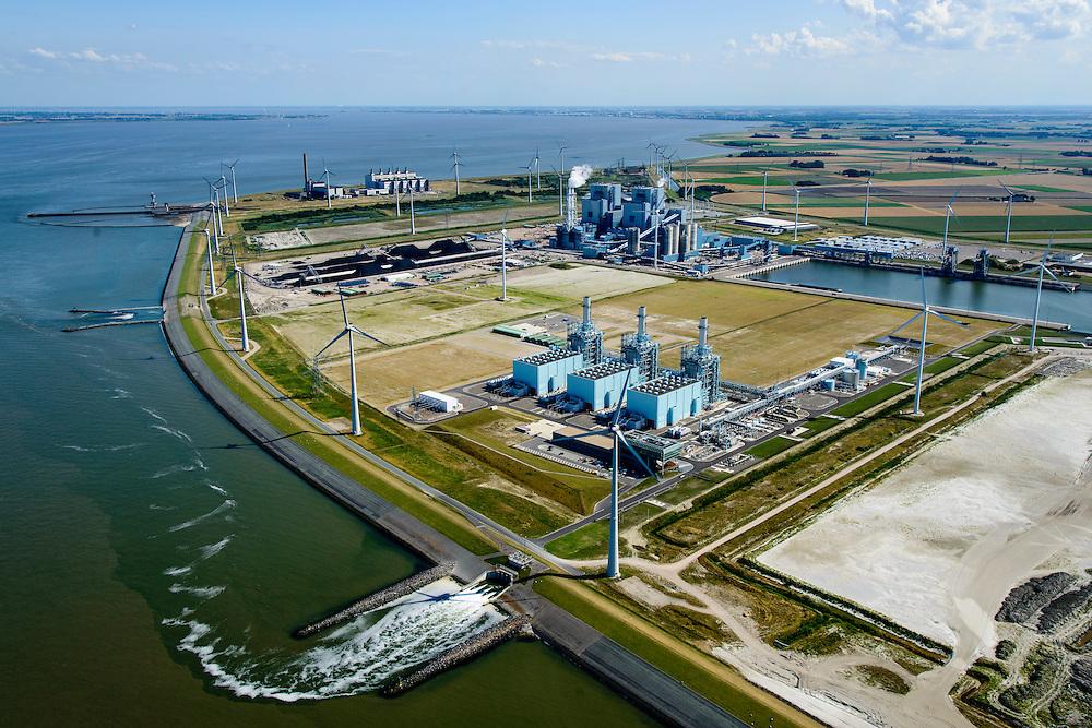 Nederland, Groningen, Eemshaven, 05-08-2014; Haven omzoomd door windmolens. Energie-landschap met elektricitieitscentrales van Nuon (midden links), de RWE-Essent elektriciteitscentrale (midden, kolencentrale) en de Eemscentrale van Electrabel (stoom- en gascentrale, STEG-centrale - achtergrond).<br /> Harbor area and energy landscape with wind turbines and different power plants:<br /> Nuon (Magnum multi-fuel plant, foreground), coal fired  RWE-Essent plant (middle) and the Electrabel STEG  power plant.<br /> <br /> luchtfoto (toeslag op standard tarieven);<br /> aerial photo (additional fee required);<br /> copyright foto/photo Siebe Swart
