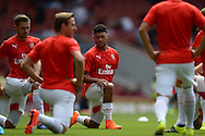 Alex Oxlade-Chamberlain of Arsenal looking on during pre-match warm up. Barclays Premier League, Arsenal v West Ham Utd at the Emirates Stadium in London on Sunday 9th August 2015.<br /> pic by John Patrick Fletcher, Andrew Orchard sports photography.