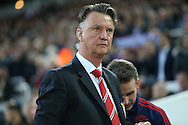 Louis van Gaal, the Manchester United Manager looks on from the bench . The Emirates FA cup, 6th round replay match, West Ham Utd v Manchester Utd at the Boleyn Ground, Upton Park  in London on Wednesday 13th April 2016.<br /> pic by John Patrick Fletcher, Andrew Orchard sports photography.