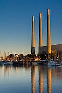 Morning light on Power Plant smoke stacks over Morro Bay harbor, California