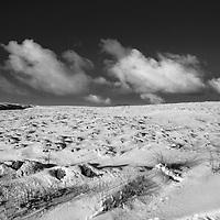Clouds over a snowy Walshaw Moor near Hebden Bridge