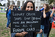 A climate activist holding a placard referring to air pollution caused by luxury cruise ships prepares to take part in a colourful Ocean Rebellion Marine Extinction March on 6 September 2020 in London, United Kingdom. The activists, who are attending a series of September Rebellion protests around the UK, are demanding environmental protections for the oceans and calling for an end to global governmental inaction to save the seas.