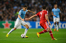 Man City Midfielder Jesus Navas (ESP) is challenged by Bayern Midfielder Franck Ribery (FRA) during the first half of the match - Photo mandatory by-line: Rogan Thomson/JMP - Tel: Mobile: 07966 386802 - 02/10/2013 - SPORT - FOOTBALL - Etihad Stadium, Manchester - Manchester City v Bayern Munich - UEFA Champions League Group D.