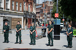 © Licensed to London News Pictures. 22/06/2020. Reading, UK. Ambulance workers observe a minutes silence near Forbury Gardens in Reading town centre, where three people were stabbed to death in a terrorist attack. Several other people were injured in the attack which was carried out by Libyan asylum seeker Khairi Saadallah, who is currently in custody. . Photo credit: Ben Cawthra/LNP