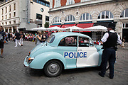 Vintage Morris Minor police car in London, United Kingdom. The Morris Minor is a British car of which more than 1.6 million were manufactured between 1948 and 1972. Initially available as a two-door saloon, the range was expanded to include a four-door saloon. It was the first British car to sell over one million units and is considered a classic example of automotive design, as well as typifying Englishness.
