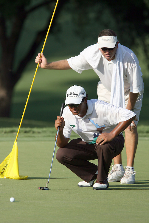09 August 2007: Michael Campbell and caddie Michael Waite analyze the 9th green during the first round of the 89th PGA Championship at Southern Hills Country Club in Tulsa, OK.