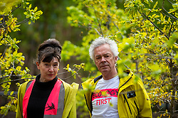 © Licensed to London News Pictures. 04/05/2021. LONDON, UK.  British artists, Heather Ackroyd (L) and Dan Harvey, collectively known as Ackroyd & Harvey, pose with their new work Beuys' Acorns, an installation of 100 oak saplings all grown from acorns, which has opened outside Tate Modern.  The work, begun in 2007, marks 100 years since the birth of Joseph Beuys (1921-86), the hugely influential artist and environmental activist. On show 4 May to 14 November 2021, it is a living sculpture where visitors can reconnect with art from lockdown, rethink their relationship to nature, and reflect on art, activism and the climate emergency.  Photo credit: Stephen Chung/LNP