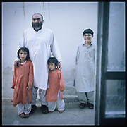 Mullah Abdul Salam Rocketi stands with his grandchildren in his home in Kabul. During the Soviet occupation of Afghanistan in the 80s, Rocketi earned his surname fighting with rocket-propelled grenades against Soviet helicopters and tanks.