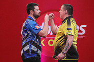 Luke Humphries wins his quarter-final match against Dave Chisnall and celebrates during the Ladbrokes UK Open Darts 2021 at stadium:mk, Milton Keynes, England. UK on 7 March 2021.