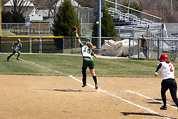 05 April 2008: Valerie Hackett can't reach an over thrown ball as Kari Peterson hustles towards 1st base. The Carthage College Lady Reds lost the first game of this double header to the Titans of Illinois Wesleyan 4-1 at Illinois Wesleyan in Bloomington, IL