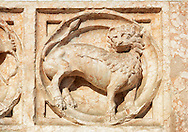 Medieval relief sculptures of mythical lion on the exterior of the Romanesque Baptistery of Parma, circa 1196, (Battistero di Parma), Italy .<br /> <br /> If you prefer you can also buy from our ALAMY PHOTO LIBRARY  Collection visit : https://www.alamy.com/portfolio/paul-williams-funkystock/romanesque-art-antiquities.html<br /> Type -     Parma    - into the LOWER SEARCH WITHIN GALLERY box. <br /> <br /> Visit our ROMANESQUE ART PHOTO COLLECTION for more   photos  to download or buy as prints https://funkystock.photoshelter.com/gallery-collection/Medieval-Romanesque-Art-Antiquities-Historic-Sites-Pictures-Images-of/C0000uYGQT94tY_Y