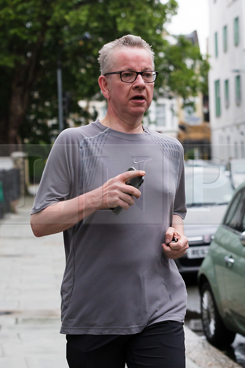© Licensed to London News Pictures. 13/06/2019. London, UK. Secretary of State for Environment, Food and Rural Affairs and Tory leadership candidate, MICHAEL GOVE MP, is seen jogging outside his London home today. Later today the first Tory leadership ballot will take place. Photo credit: Vickie Flores/LNP