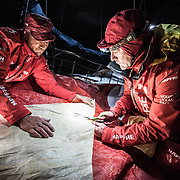 Leg 7 from Auckland to Itajai, day 12 on board MAPFRE, Santi and Blair cutting a piece of 3Di for the mainsail, 30 March, 2018.