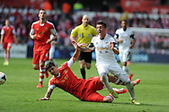 Southampton's Jose Fonte (l) fouls Swansea's Pablo Hernandez. Barclays Premier league match, Swansea city v Southampton at the Liberty stadium in Swansea, South Wales on Saturday 3rd May 2014.<br /> pic by Andrew Orchard, Andrew Orchard sports photography.