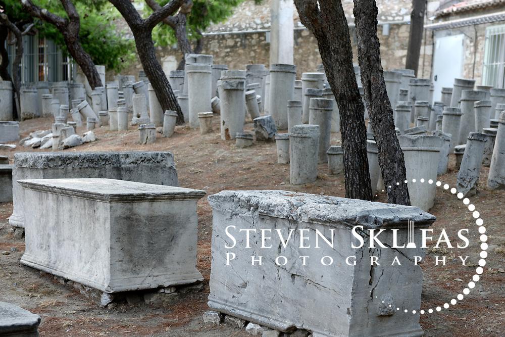 Hellenistic funerary markers, plain trapeze (stone tables) and kioniskos (small columns). Kerameikos. Athens. Greece.