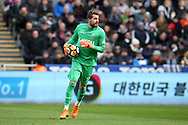 Kristoffer Nordfeldt, the Swansea city goalkeeper in action. The Emirates FA Cup, quarter-final match, Swansea city v Tottenham Hotspur at the Liberty Stadium in Swansea, South Wales on Saturday 17th March 2018.<br /> pic by  Andrew Orchard, Andrew Orchard sports photography.