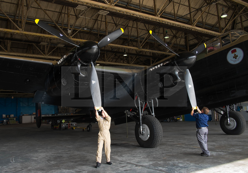 © Licensed to London News Pictures. <br /> 28/08/2014. <br /> <br /> Durham Tees Valley Airport, United Kingdom<br /> <br /> The giant propellers of one of only two remaining flying Avro Lancaster bombers are straightened as it visits Durham Tees Valley airport today. <br /> <br /> The aircraft, 'Mynarski' is named after Pilot Officer Andrew Mynarski who flew with the Canadian Royal Air Force from the airport which was then called RAF Middleton St George.<br /> <br /> Pilot Officer Mynarski was posthumously awarded a VC after giving his life while trying to save a colleague when their Lancaster was shot down in June 1944.<br /> <br /> The famous World War Two aircraft is owned by the Canadian Warplane Heritage Museum and is beginning a 2-week tour of the UK.<br /> <br /> Photo credit : Ian Forsyth/LNP