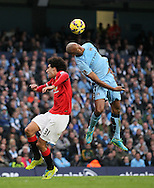 Manchester City's Vincent Kompany tussles with Manchester United's Marouane Fellaini<br /> <br /> - Barclays Premier League - Manchester City vs Manchester Utd - Etihad Stadium - Manchester - England - 2nd November 2014  - Picture David Klein/Sportimage
