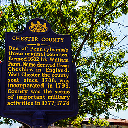 West Chester, PA, USA - August 5, 2020: A Pennsylvania Historical Marker Sign noting the formation of Chester Couty by William Penn.