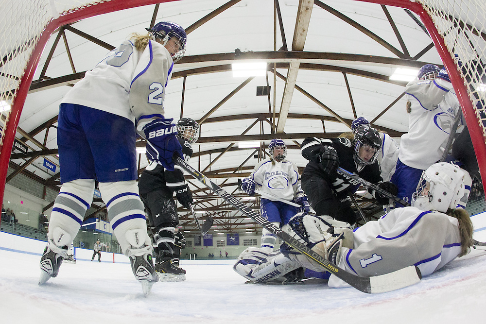 Jessica Thulin and Jackie Tavella, of Colby College, in a NCAA Division III hockey game against Bowdoin College on November 21, 2014 in Waterville, ME. (Dustin Satloff/Colby College Athletics)