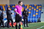 AFC Wimbledon coach Rob Tuvey shouting from touchline during the EFL Sky Bet League 1 match between AFC Wimbledon and Hull City at Plough Lane, London, United Kingdom on 27 February 2021.