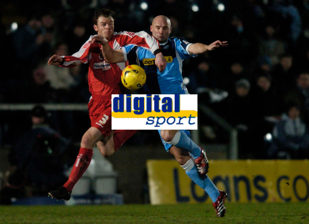 Photo. Richard Lane.<br />Wycombe Wanderers v Leyton Orient. Coca Cola League Two. 29/12/2005.<br />Wycombe's Tommy Mooney  challenges Matt Lockwood.