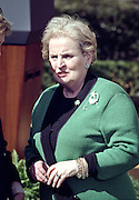 US Secretary of State Madeleine Albright wearing a green sweater during a St. Patrick's Day event in the Rose Garden with Irish Prime Minister Bertie Ahern March 17, 1999 at the White House, Washington, DC.