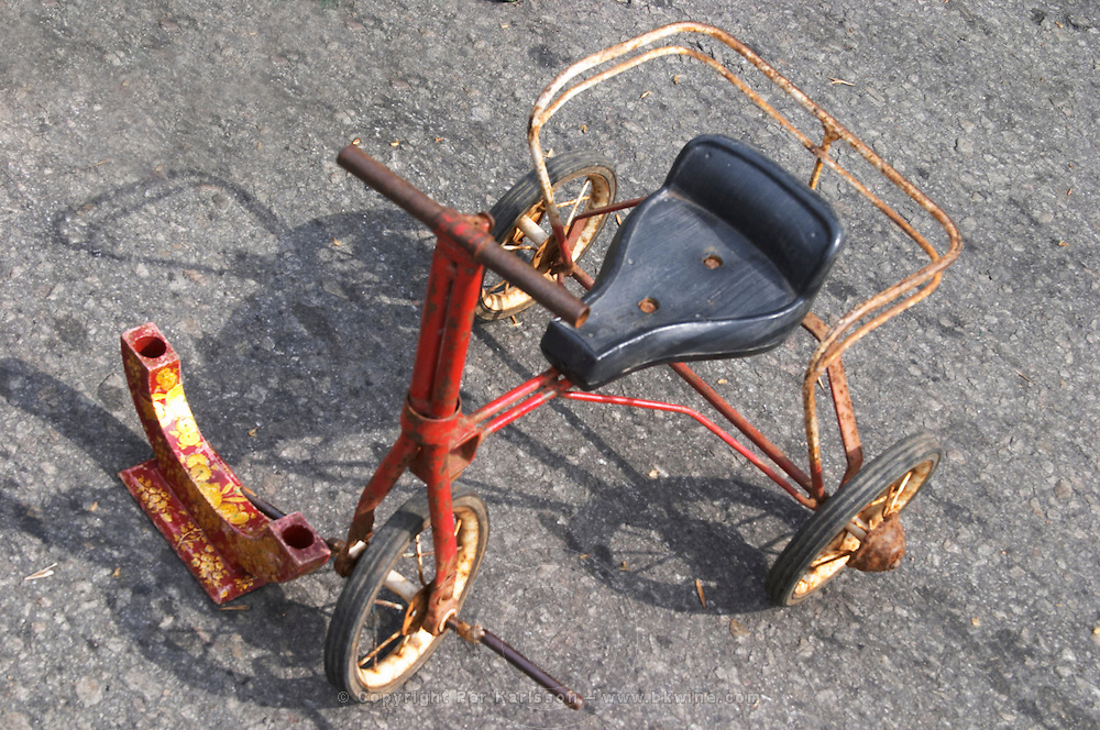 An old rusty child's tricycle on sale at A market stall street market merchant Montevideo, Uruguay, South America