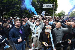 © Licensed to London News Pictures. 23/05/2021. Manchester, UK.  Man City fans let off flares outside the Etihad Stadium on Sunday. Thousands of supporters have gathered at the Etihad Stadium to celebrate winning their 5th Premier League title in 10 years.  Photo credit: Adam Vaughan/LNP