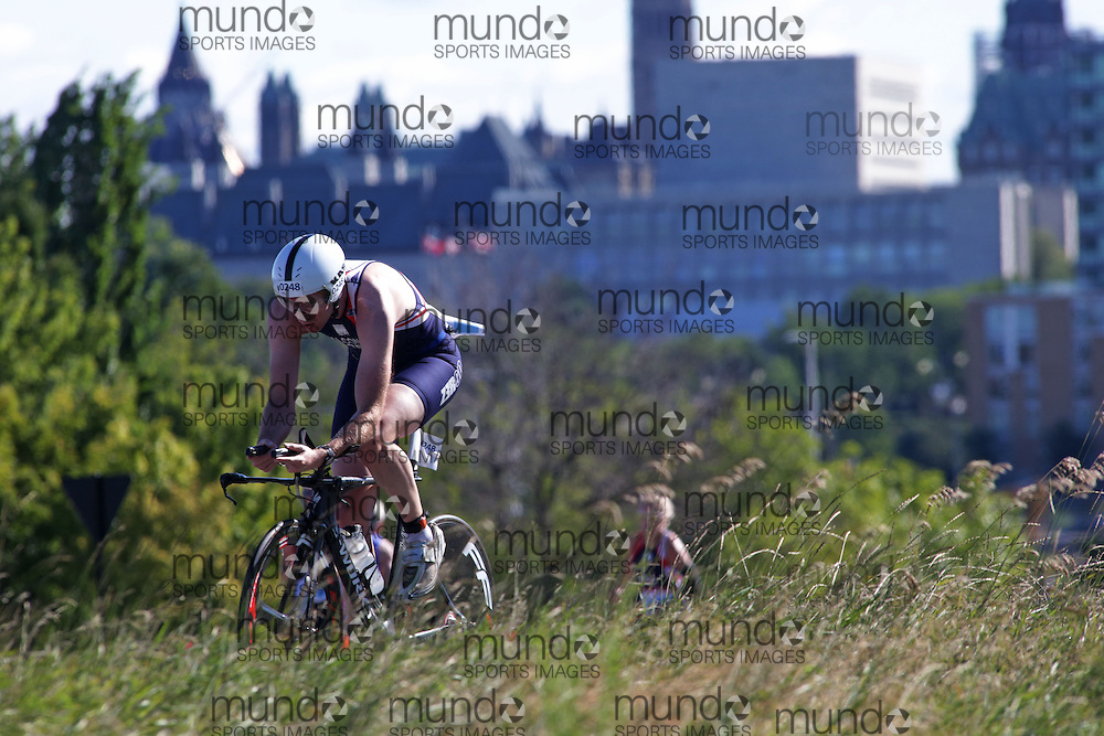 (Ottawa, Canada---10 August 2013)  Dan Falconar (248)  of Great Britain (GBR) competing in the 30-34 Male AG International Triathlon Union 2013 World Duathlon Championships (10 km run- 40 km bike- 5km run).