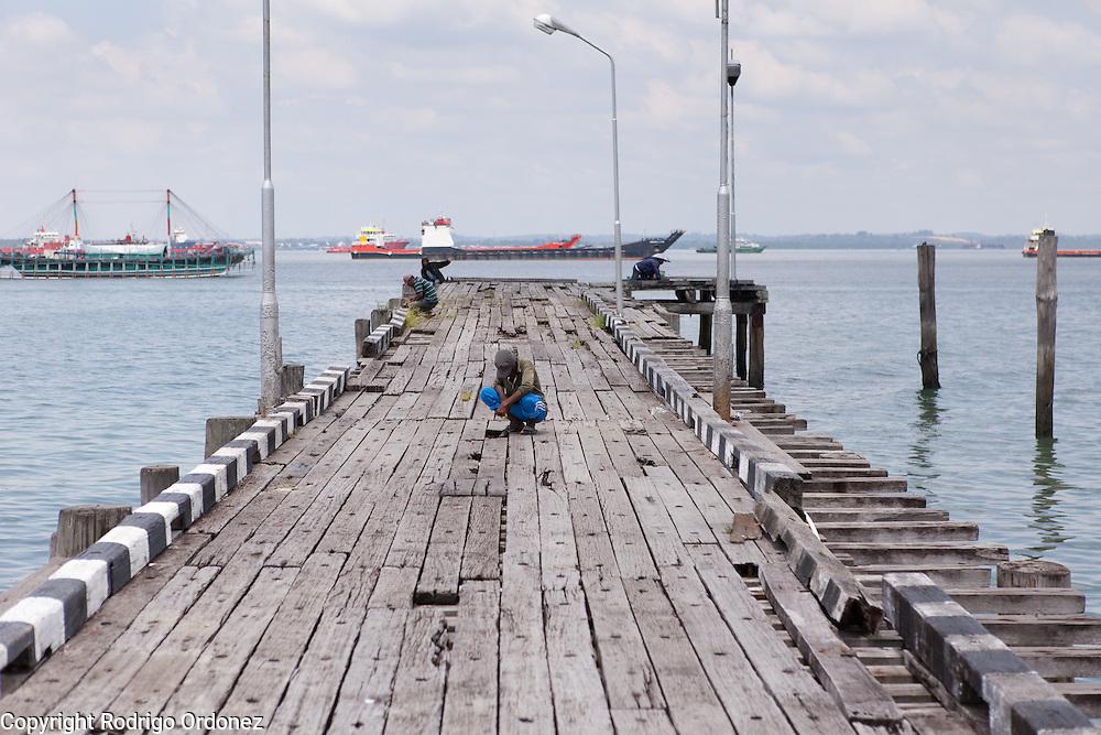 A man stands on a jetty near Balikpapan, East Kalimantan, Indonesia, on March 12, 2016. <br /> (Photo: Rodrigo Ordonez)