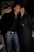 Julian Macdonald and Isabella Blow. Julian Macdonald after show party. Umbaba. 15-21 Ganton St. London. 13 February 2005. ONE TIME USE ONLY - DO NOT ARCHIVE  © Copyright Photograph by Dafydd Jones 66 Stockwell Park Rd. London SW9 0DA Tel 020 7733 0108 www.dafjones.com