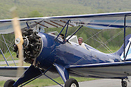 Wurtsboro, NY - A 1941 Waco UPF-7 biplane taxis on the runway after a sightseeing ride during the grand reopening of Wurtsboro Airport on May 11, 2008.