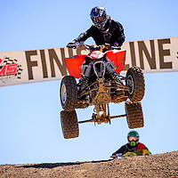 100414       Cable Hoover<br /> <br /> Benjamin Harvey leads the pack in the Quad Open race of the Scott Costley Memorial Motocross race Saturday at the Gallup OHV MX Park.